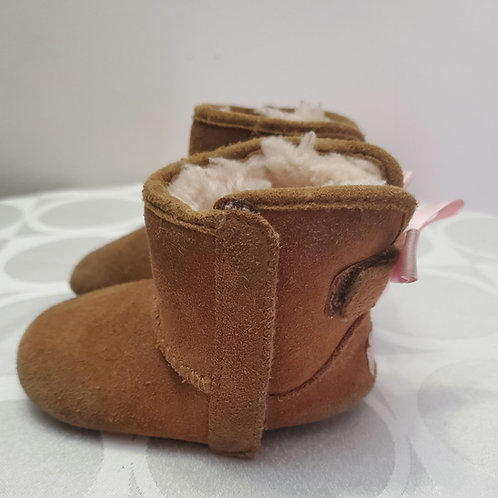 Kids ugg boots with pink ribbon