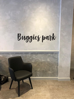 Buggies park letters applied to wall in Esquires Coffee
