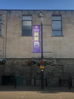 Mesh lamppost banner