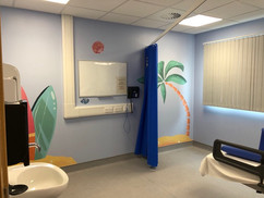Surf boards and palm trees applied to walls of the children's ward at Warwick Hospital