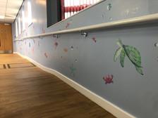 Vinyl sea creatures applied to a corridor in Warwick Hospital's children's ward