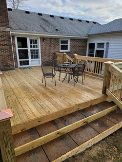 pressure treated deck materials with stone steps