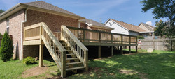 Pressure treated deck materials with double sided handrails