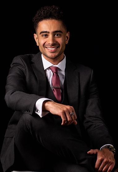 Young man smiling in a suit