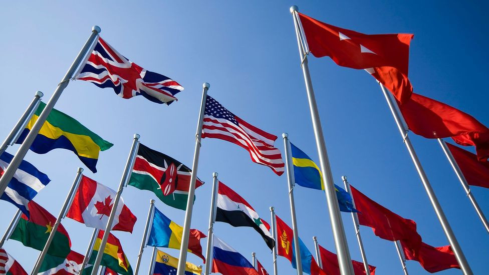 World flags with blue sky background