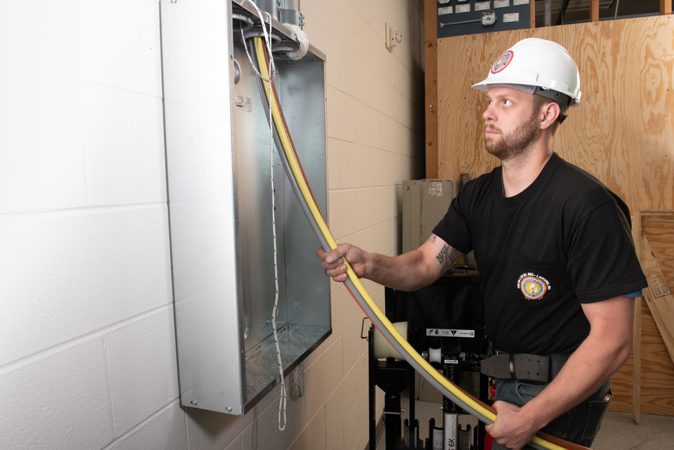 Union Man Carefully Watches Wires.jpg