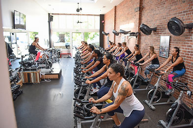 Spin class in spin studio on spin bikes for indoor cycling