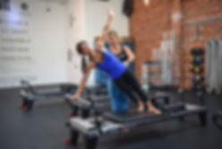Pilates reformer in pilates reformer class with instructor