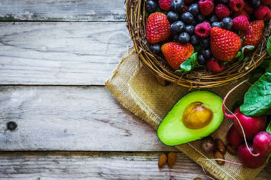 Fruits and vegetables on rustic backgrou