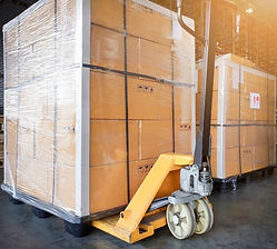 large-shipment-pallet-goods-yellow-hand-pallet-truck-cargo-export-shipping-warehouse_36860