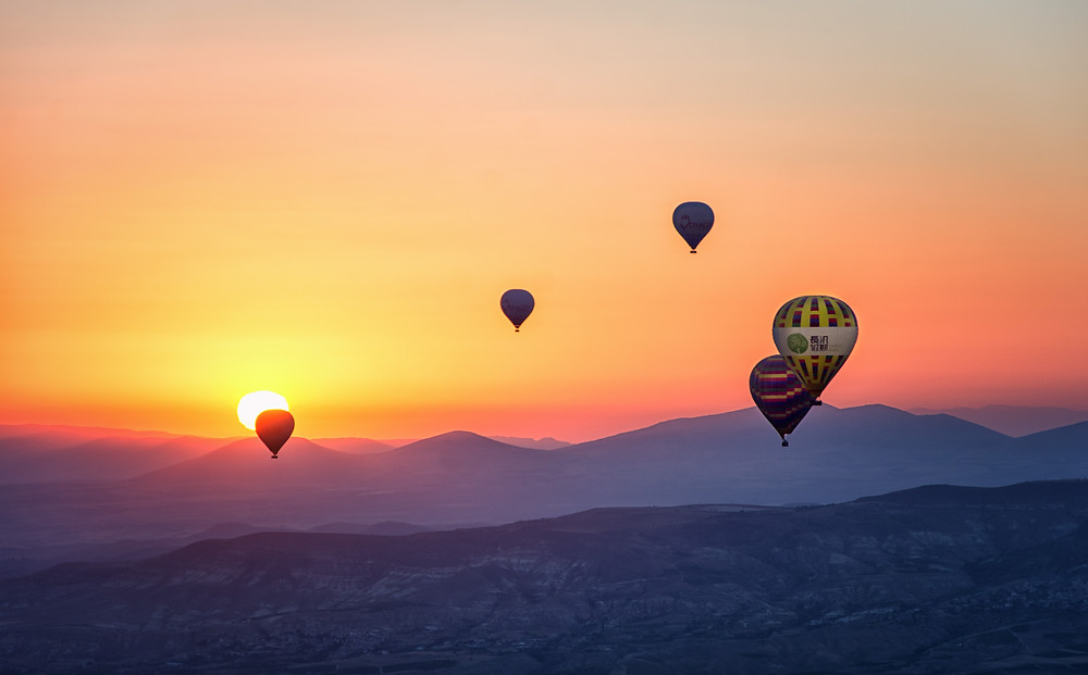 Beautiful sunset with hot air balloons