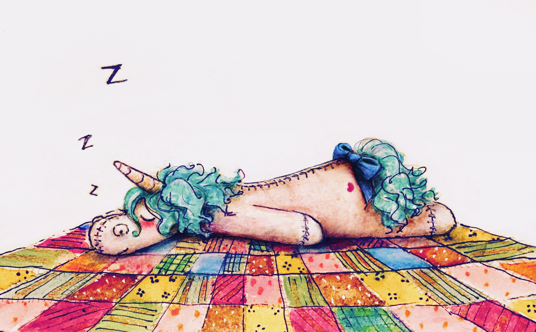 Unicorn Asleep on Patchwork Bed