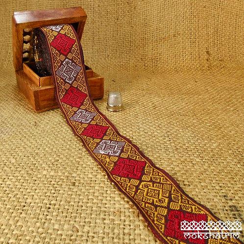 Asian/Indian ethnic decorativejacquard ribbon made and sold as a full sari trim. Wine Red golden yellow Mokshatrim Haberdash