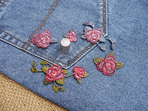 Embroidered appliques with a red blue rose flower design. Rose flower glittery thread texture Mokshatrim Haberdashery
