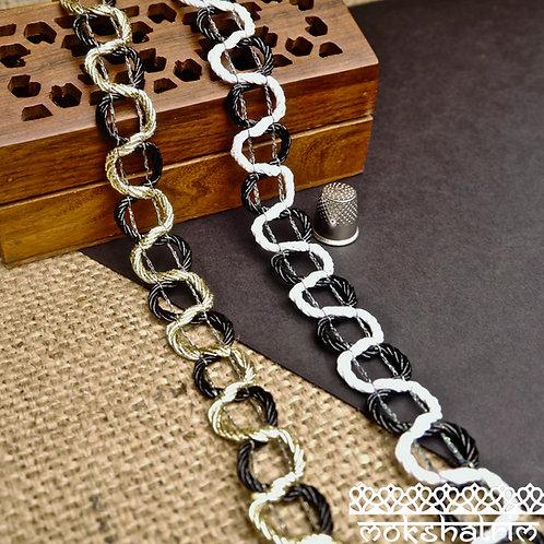 Shiny black irridescent white gold metallic dual monochrome Chain Braid gimp trim invisible thread Mokshatrim Haberdashery
