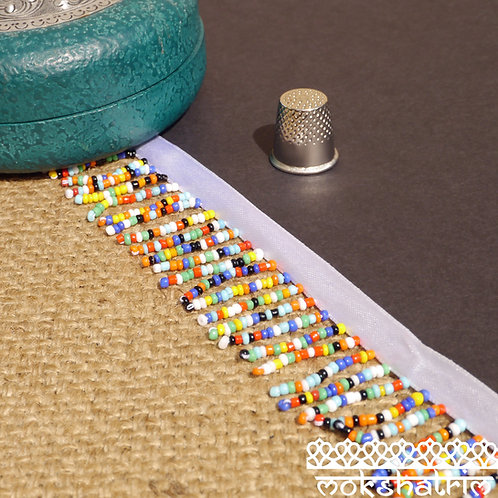 40mm Beaded trim fringe multicoloured rainbow seed beads white satinribbon Mokshatrim Haberdashery