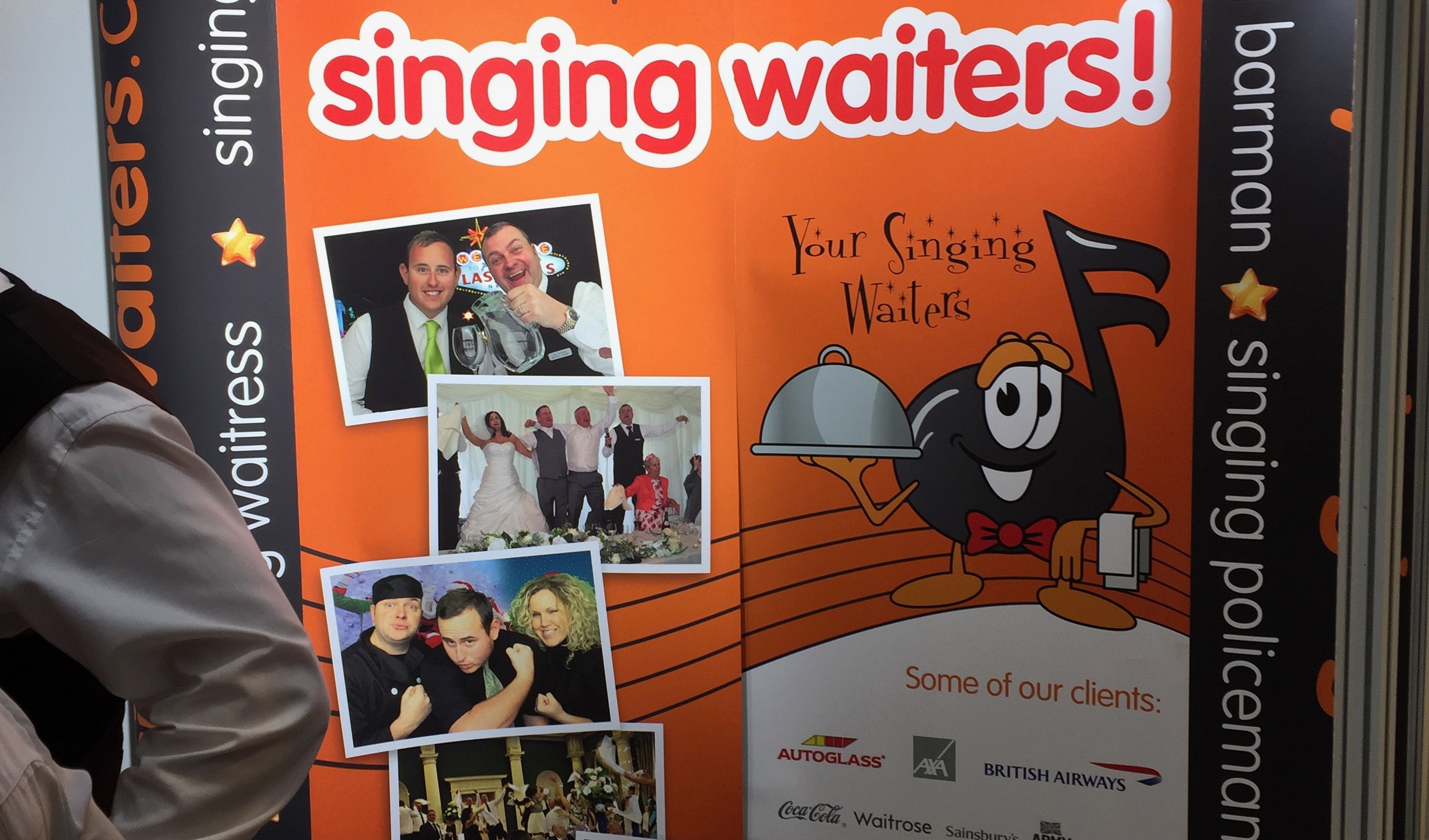 The singing waiters were getting A LOT of female attention