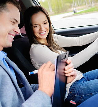 Driving instructor and woman student in