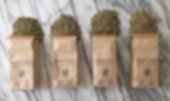 4 bags green coffee marble.png