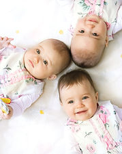 Baby triplets portrait view from above.j