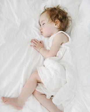Adorable toddler girl sleeping like an a