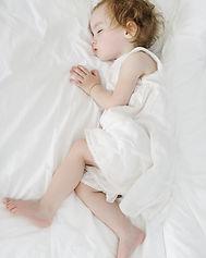 Adorable toddler girl sleeping like an a