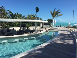 The Shore Club in Turks & Caicos, Family Pool.   Elli Travel Group is a New York based travel agency specializing in luxury travel. How can I upgrade my Turks and Caicos Experience? Through Elli Travle Group clients receive complimentary amenities.  We are proud members of Virtuoso, Rosewood Elite, and Starwood Luxury Privileges.