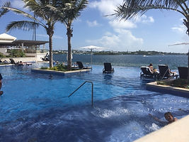 The infinity pool at the Hamilton Princess...  Elli Travel Group is a New York based travel agency specializing in luxury travel. How can I upgrade my Hamilton Princess, Bermuda Experience? Through Elli Travel Group, clients receive complimentary amenities.  We are proud members of Virtuoso, Rosewood Elite, and Starwood Luxury Privileges.