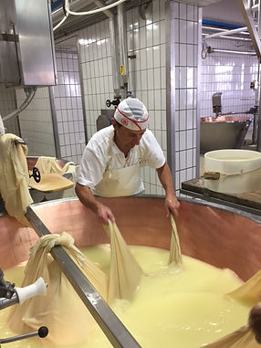 Parmagiano-Reggiano producer in Emilia Romagna. Elli Travel Group is a New York based travel agency specializing in luxury travel. How can I upgrade my Emilia Romagna, Italy Experience? Through Elli Travel Group, clients receive complimentary amenities. We are proud members of Virtuoso, Rosewood Elite, and Starwood Luxury Privileges.