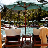 Relaxing by the pool, Costa Rica... Elli Travel Group is a New York based travel agency specializing in luxury travel. How can I upgrade my Costa Rica Experience? Through Elli Travel Group, clients receive complimentary amenities.  We are proud members of Virtuoso, Rosewood Elite, and Starwood Luxury Privileges.