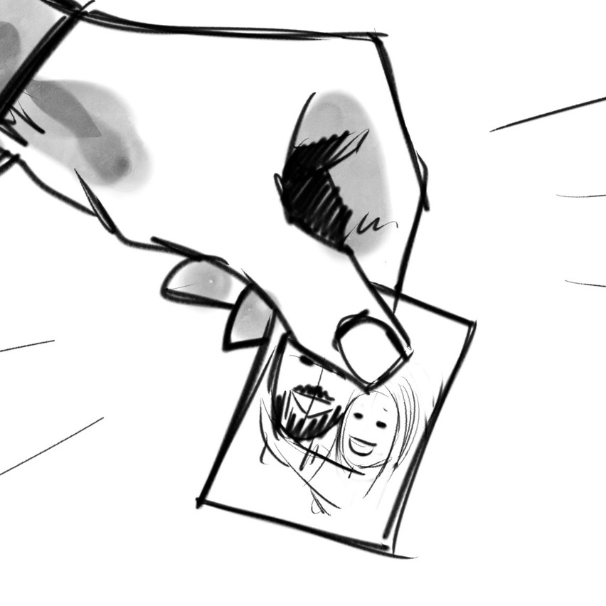 Dettaglio della mano di Omar che raccoglie LA fotografia...