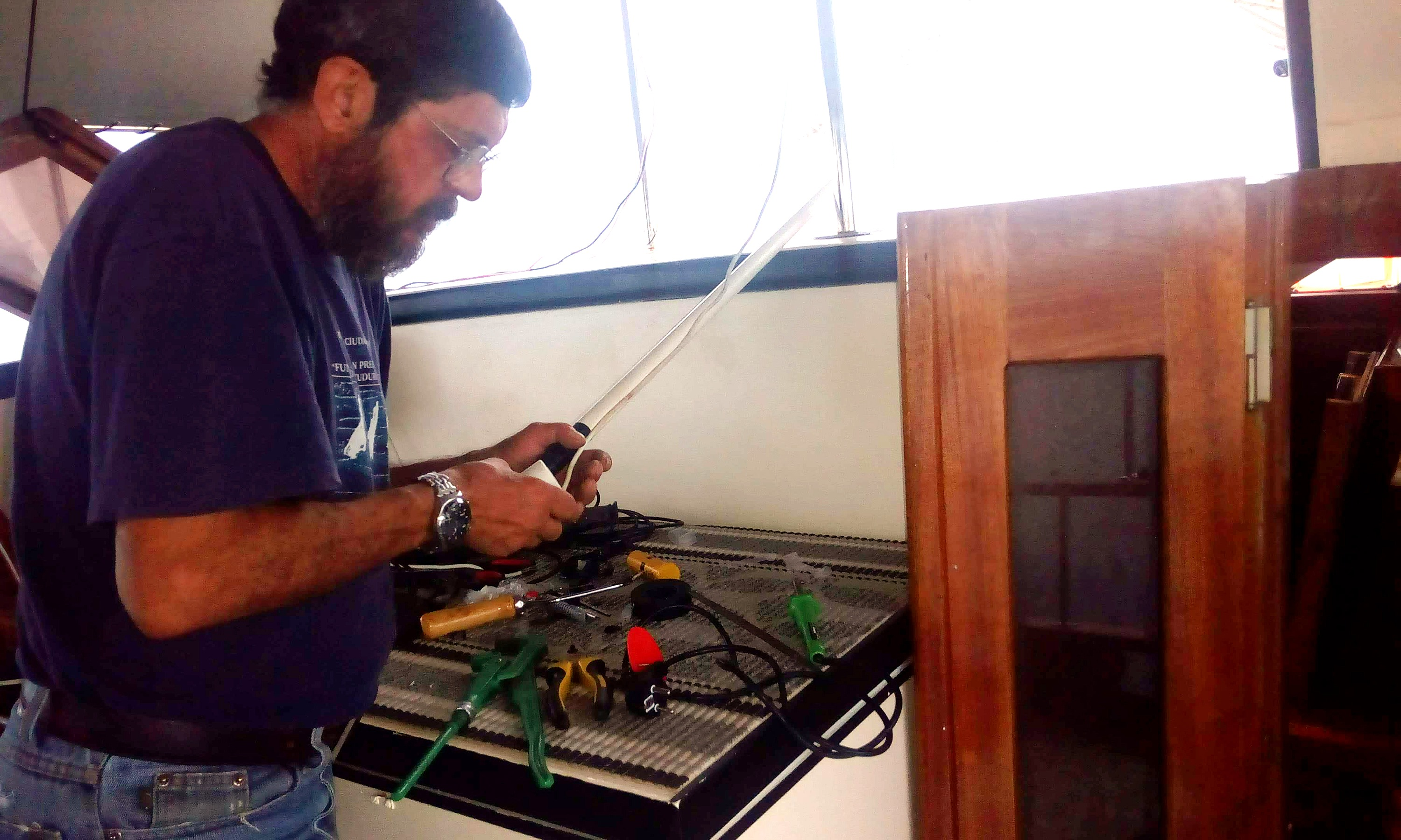 Maria's father working on the  wiring