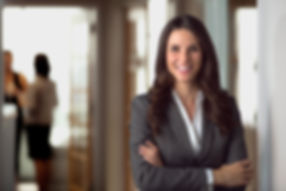 Woman in a business suit smiling at the viewer