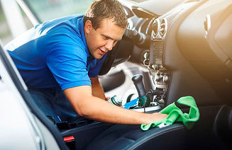 man-washing-cleaning-car-interior-wiping