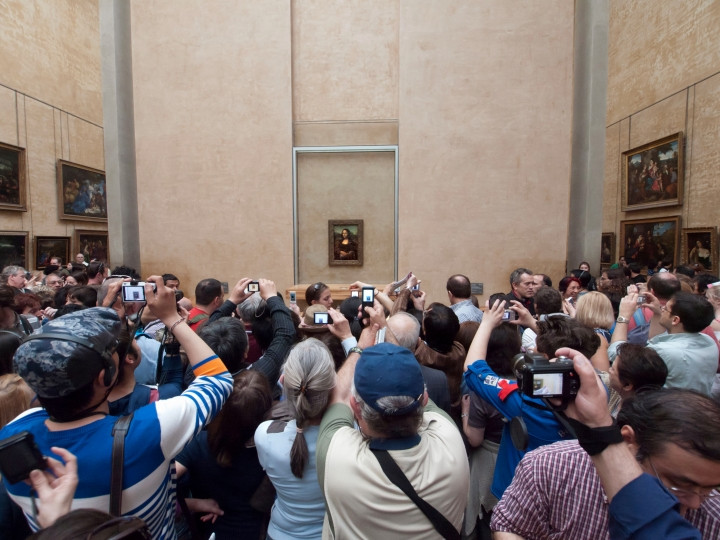 Tourists taking pictures of the Mona Lisa
