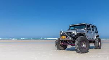 grey jeep on beach.jpg