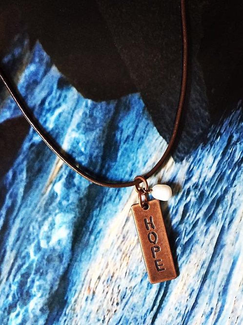 Hope Stamp and Pearl Neckalce