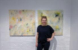 art by olga in front of paintings.jpg