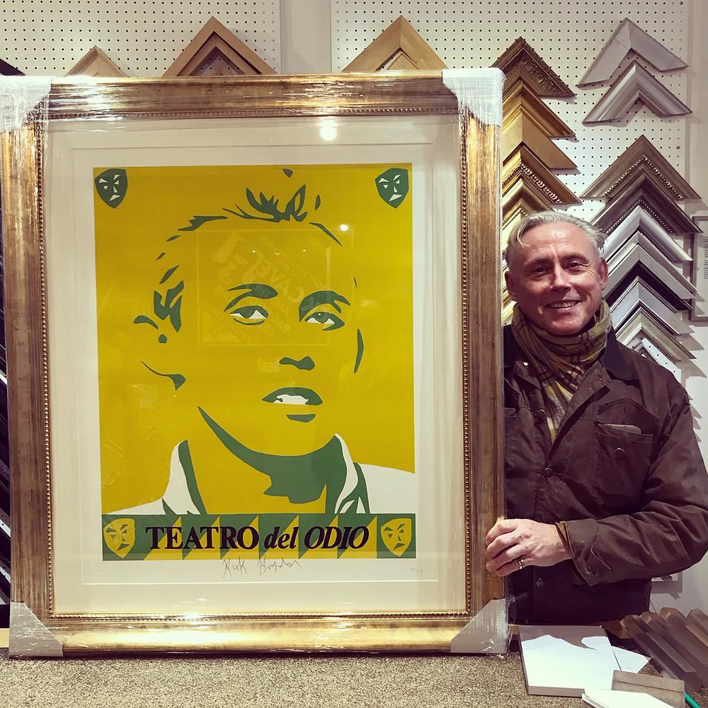 Kirk Brandon picking up his framed print by Simon Dixon