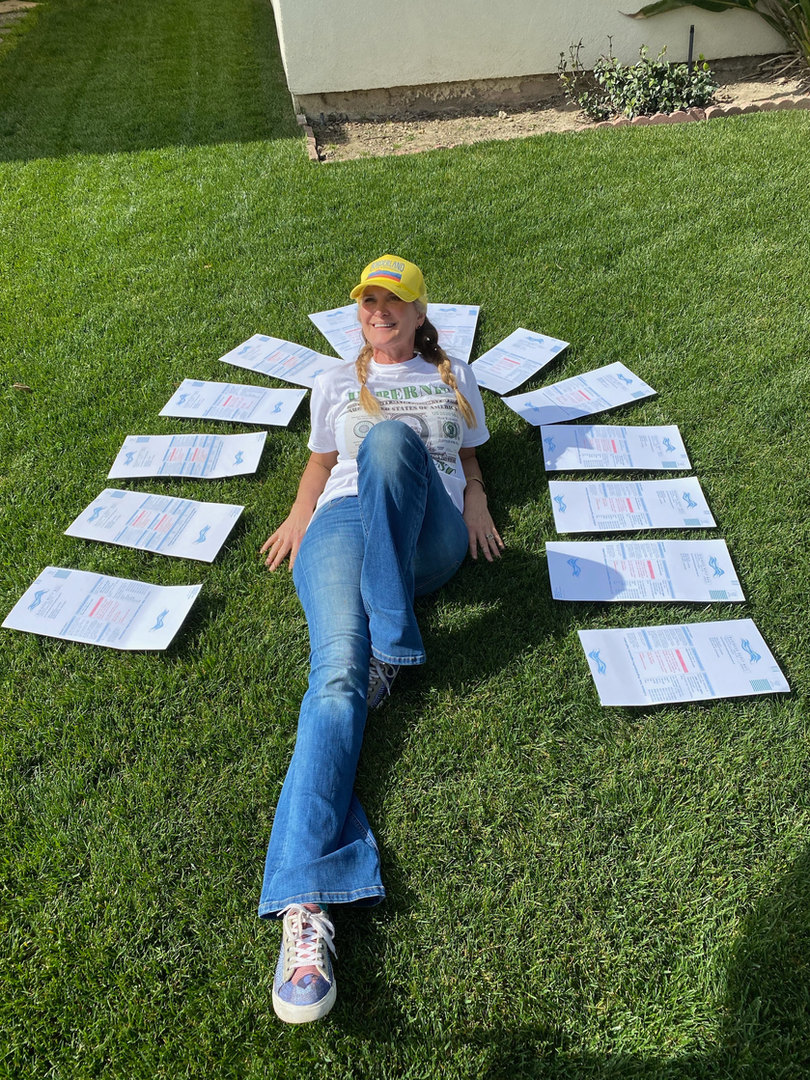 Wendy Brazill relaxes under a rainbow of new Democrats.