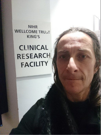Picture of Julian Outside the Research Facility Sign