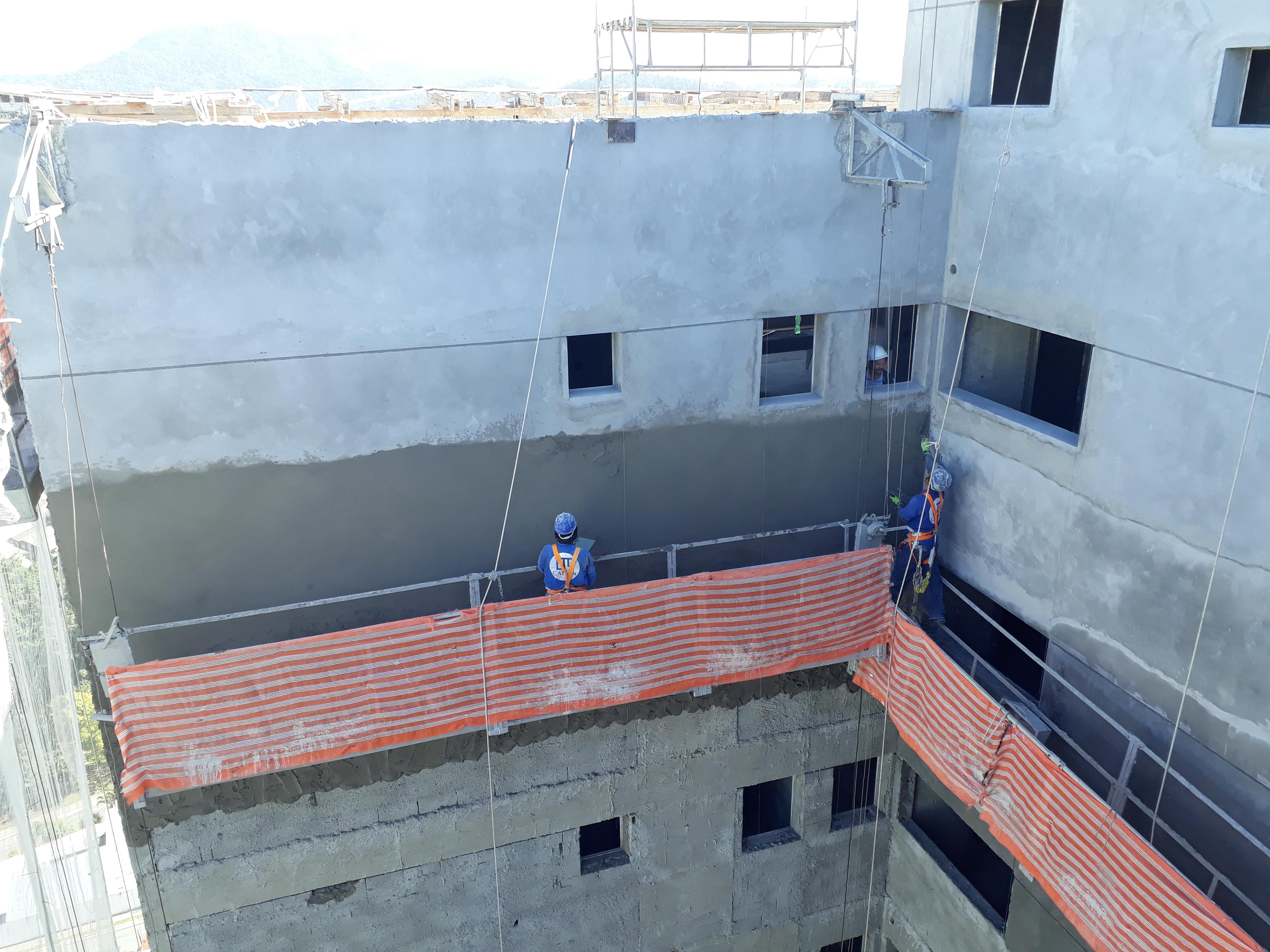 Execução de revestimento em massa - fachada lateral esquerda