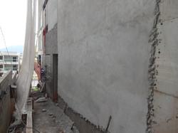 Execução massa fachada - periferia lateral esquerda