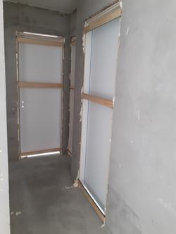 Colocação de portas dos dormitórios