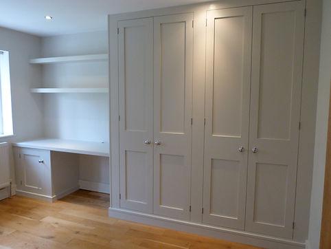 built-in 4 door shaker style wardrobe, desk supported by single door cupboard, floating shelves above