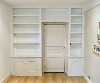 built-in Shaker style wall to wall unit with 2 door alcove cupboard and 1 door cupboard with modern shelving above