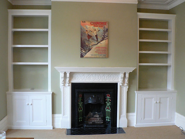 built-in pair of painted, traditional, Victorian style alcove cupboards and bookcases