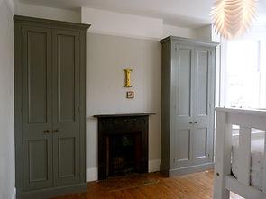 built-in pair of painted two door wardrobes
