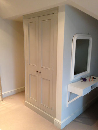 built-in two door wardrobe airing cupboard