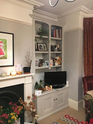 built-in alcove cupboard and decorative split bookcase